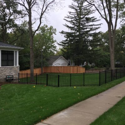 Aluminum and Wood fences installed by First Fence Company